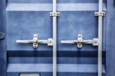 Blue metal door on a large shipping container