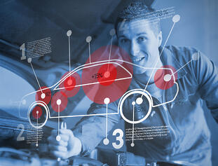 Mechanic reparing car while consulting futuristic interface in blue